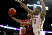 Deverell Biggs of the Nebraska Cornhuskers goes up for a layup while being defended by Amir Williams of the Ohio State Buckeyes during the first half...