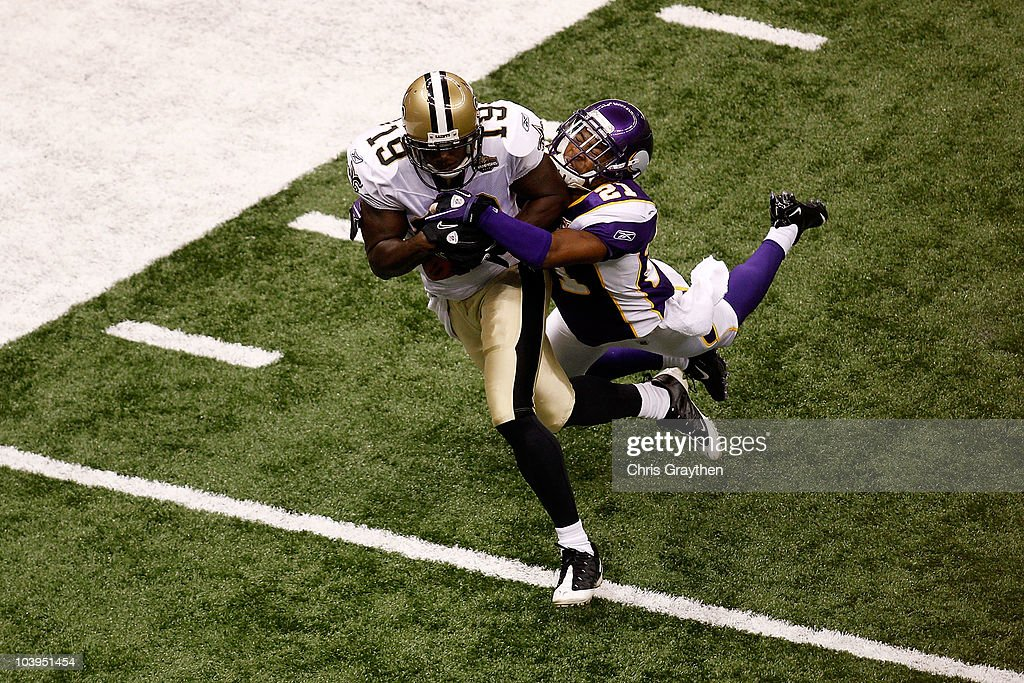 Devery Henderson of the New Orleans Saints catches a 29yard touchdown reception in the first quarter against Asher Allen of the Minnesota Vikings at...