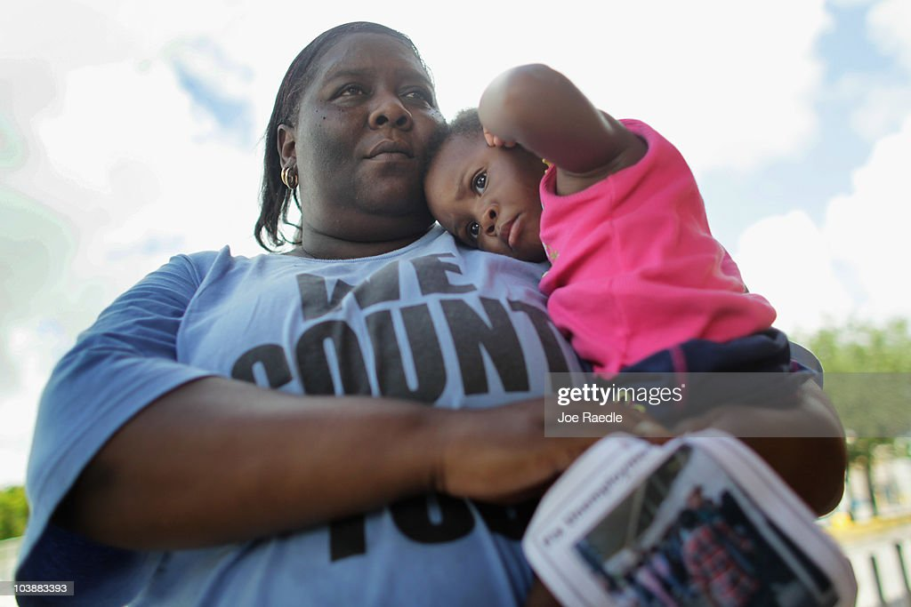 Devetria Stratford holds her daughter, Lee Andrea Stratford, as she attends a rally asking for Florida Governor Charlie Crist to sign an executive order for unemployment compensation reform on September 7, 2010 in Miami, Florida. Devetria has been out of work for two years and is one of many people struggling to find work with the unemployment rate in Florida staying around 11.5 percent. According to reports, Florida would be eligible for more than $400 million in federal stimulus money if the state modernizes its unemployment system.