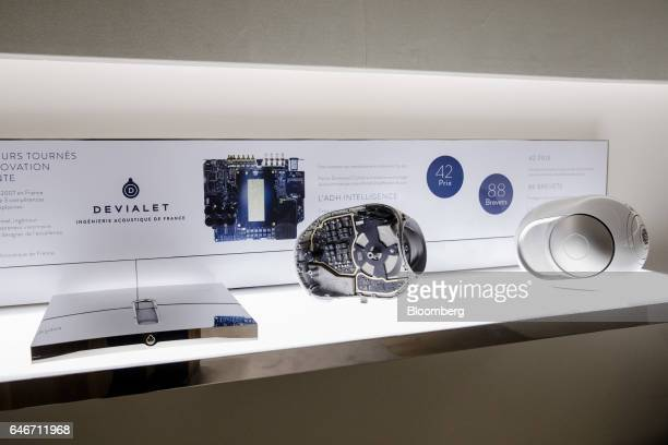 A Devialet SAS EXPERT amplifier left and a Phantom wireless speakers sit on display at the Analogue Digital Hybrid amplification technology company's...