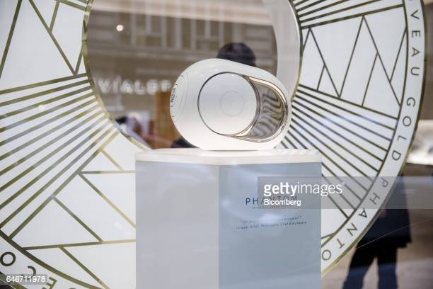 A Devialet SAS Phantom wireless speaker sits on display in the window at the Analogue Digital Hybrid amplification technology company's showroom in...
