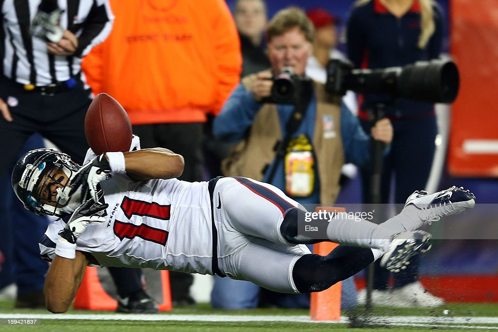 DeVier Posey #11 of the Houston Texans brings in a catch for a touchdown in the fourth quarter against the New England Patriots during the 2013 AFC Divisional Playoffs game at Gillette Stadium on January 13, 2013 in Foxboro, Massachusetts.