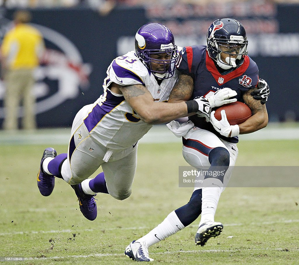 <a gi-track='captionPersonalityLinkClicked' href=/galleries/search?phrase=DeVier+Posey&family=editorial&specificpeople=5571641 ng-click='$event.stopPropagation()'>DeVier Posey</a> #11 of the Houston Texans is tackled from behind by Kevin Williams #93 of the Minnesota Vikings at Reliant Stadium on December 23, 2012 in Houston, Texas. Minnesota Vikings defeat the Houston Texans 23-6.