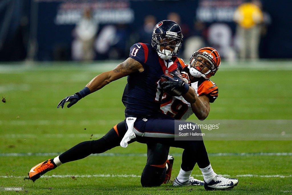 <a gi-track='captionPersonalityLinkClicked' href=/galleries/search?phrase=DeVier+Posey&family=editorial&specificpeople=5571641 ng-click='$event.stopPropagation()'>DeVier Posey</a> #11 of the Houston Texans makes a reception against <a gi-track='captionPersonalityLinkClicked' href=/galleries/search?phrase=Leon+Hall&family=editorial&specificpeople=223989 ng-click='$event.stopPropagation()'>Leon Hall</a> #29 of the Cincinnati Bengals during their AFC Wild Card Playoff Game at Reliant Stadium on January 5, 2013 in Houston, Texas.