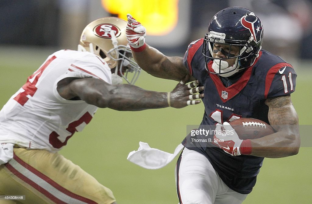 <a gi-track='captionPersonalityLinkClicked' href=/galleries/search?phrase=DeVier+Posey&family=editorial&specificpeople=5571641 ng-click='$event.stopPropagation()'>DeVier Posey</a> #11 of the Houston Texans stiff arms Asante Cleveland #45 of the San Francisco 49ers in the first quarter in a pre-season NFL game on August 28, 2014 at NRG Stadium in Houston, Texas.