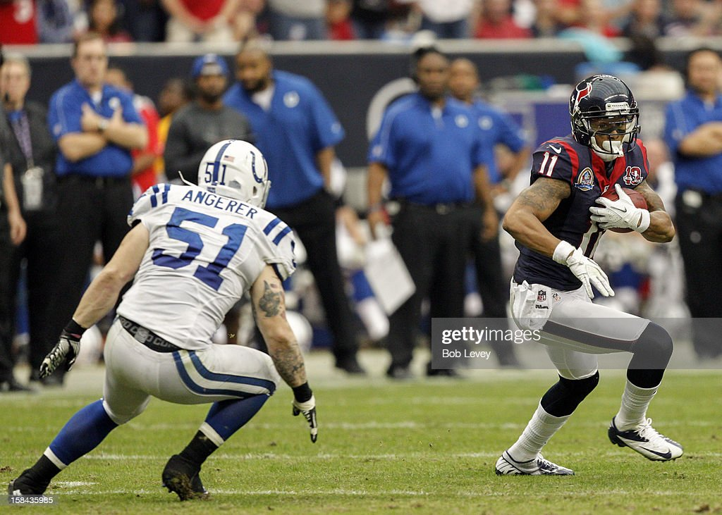 <a gi-track='captionPersonalityLinkClicked' href=/galleries/search?phrase=DeVier+Posey&family=editorial&specificpeople=5571641 ng-click='$event.stopPropagation()'>DeVier Posey</a> #11 of the Houston Texans tries to run past Pat Angerer #51 of the Indianapolis Colts in the second half at Reliant Stadium on December 16, 2012 in Houston, Texas. Texans win 29-17 to clinch the AFC South.