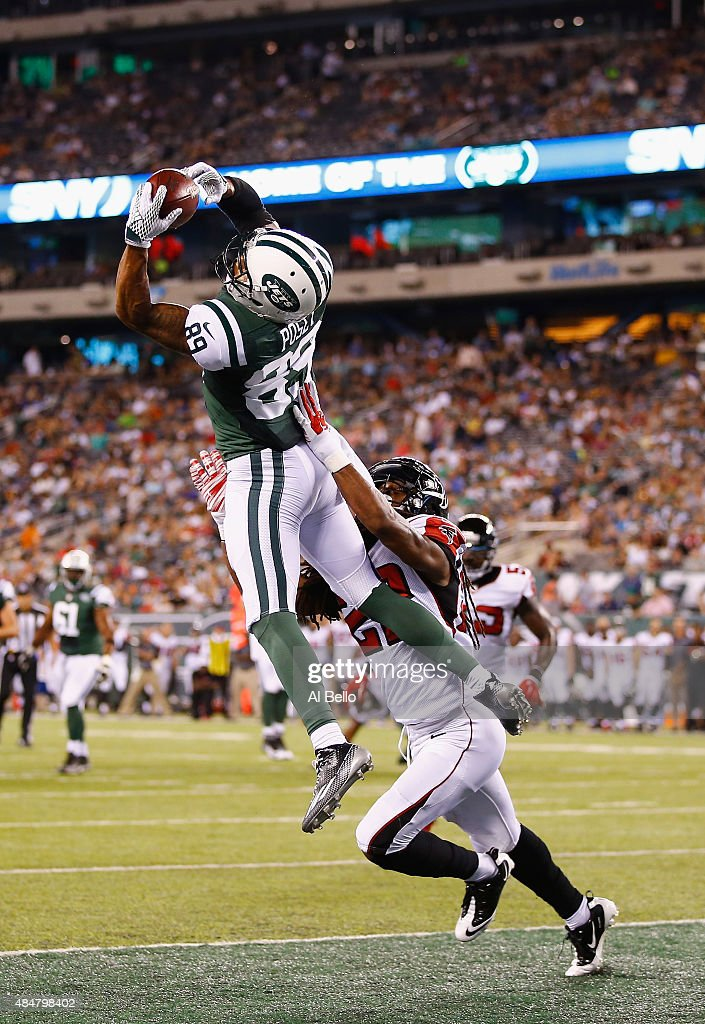 <a gi-track='captionPersonalityLinkClicked' href=/galleries/search?phrase=DeVier+Posey&family=editorial&specificpeople=5571641 ng-click='$event.stopPropagation()'>DeVier Posey</a> #89 of the New York Jets scores a touchdown against Dezmen Southward #22 of the Atlanta Falcons in the third quarter during their pre season game at MetLife Stadium on August 21, 2015 in East Rutherford, New Jersey.