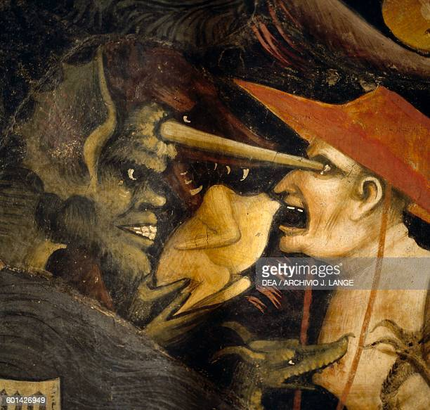 A devil and a damned man The inferno by Giovanni da Modena detail from the Bolognini chapel Basilica of St Petronio Bologna Italy 15th century