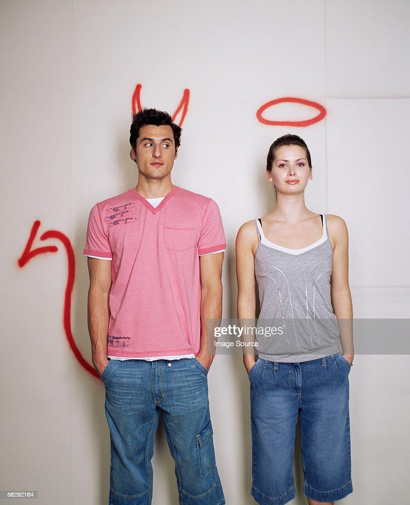 Devil and saint couple : Stock Photo