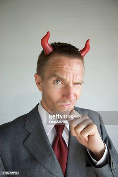 Devilish Businessman with Devil Horns Smirking