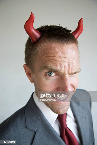 Devilish Horny Businessman With Mischief in His Eyes