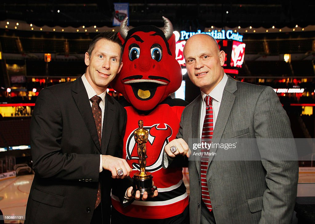Devils' alumni Grant Grant (L) and Ken Daneyko pose with mascot NJ Devil with the 'Oscar' prior to the game between the New York Rangers and the New Jersey Devils at the Prudential Center on February 5, 2013 in Newark, New Jersey.