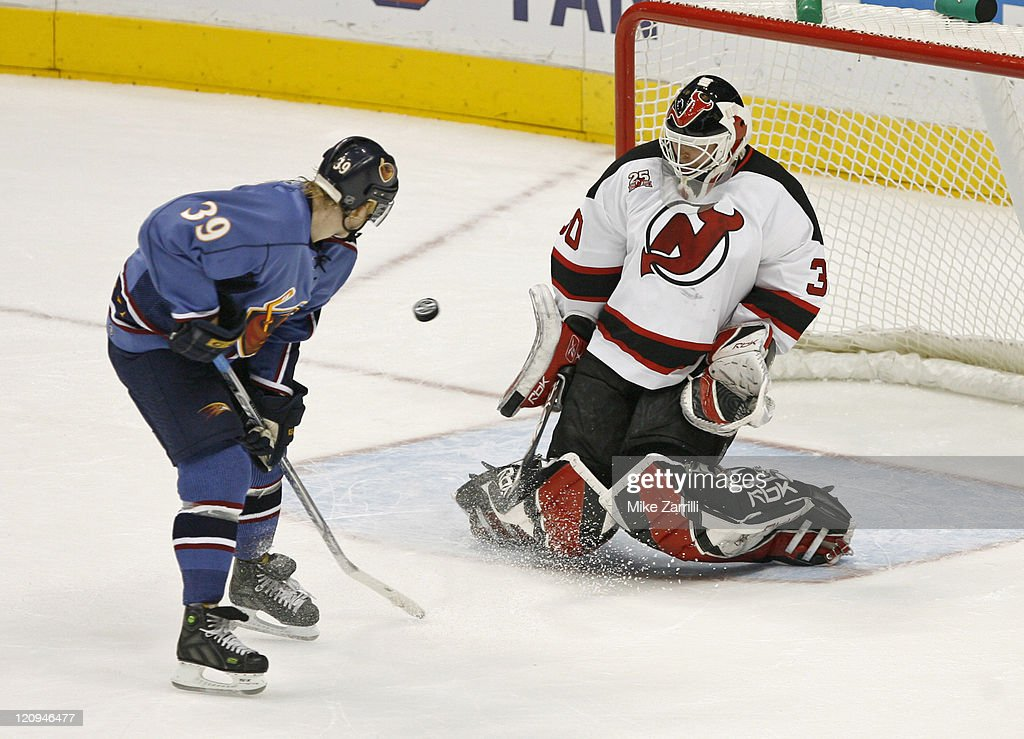 Devils goalie Martin Brodeur makes a save on a shot by Thrashers center Niko Kapanen during the game between the Atlanta Thrashers and the New Jersey...
