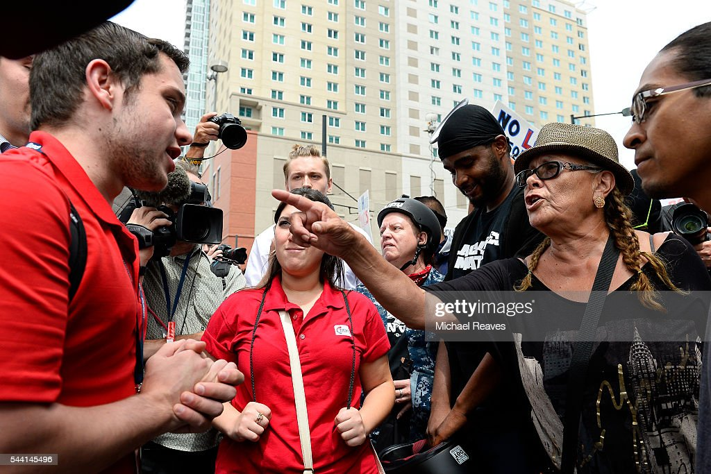 Devin Bilski, left, argues with a anti-Trump protestor outside the Western Conservative Summit on July 1, 2016.