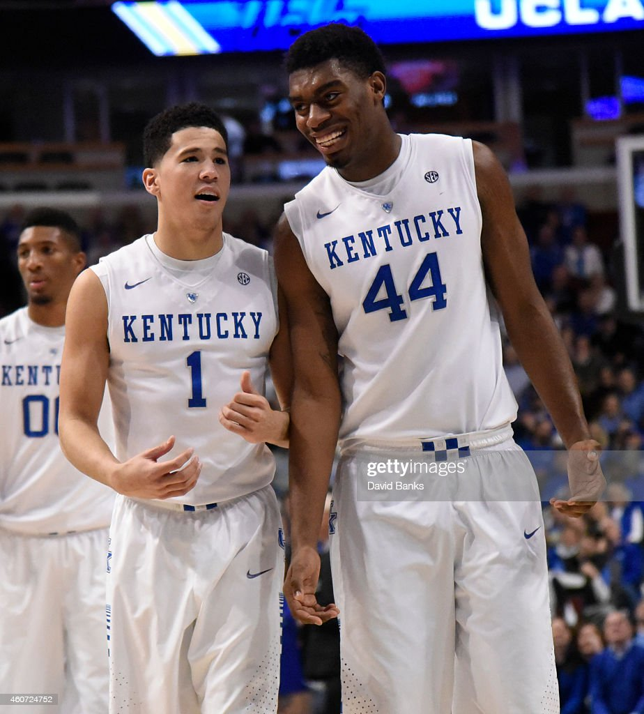 Devin Booker and center Dakari Johnson of the Kentucky Wildcats share a laugh during the second half of the CBS Sports Classic against the UCLA...