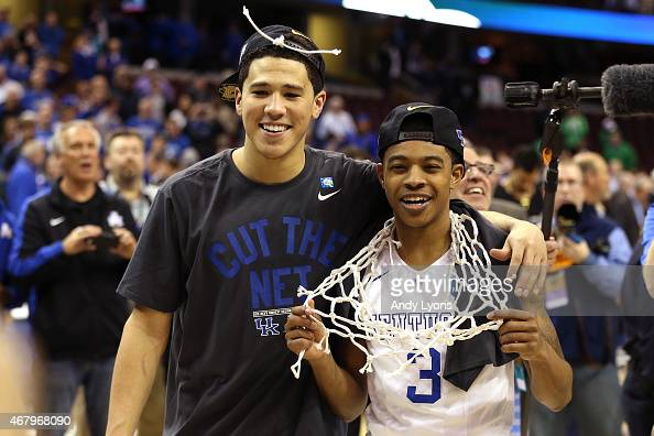Devin Booker and Devin Booker of the Kentucky Wildcats celebrate after defeating the Notre Dame Fighting Irish during the Midwest Regional Final of...