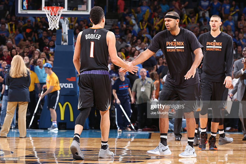 Devin Booker #1 and Jared Dudley #3 of the Phoenix Suns react during the game against the Oklahoma City Thunder on October 28, 2016 at the Chesapeake Energy Arena in Oklahoma City, Oklahoma.