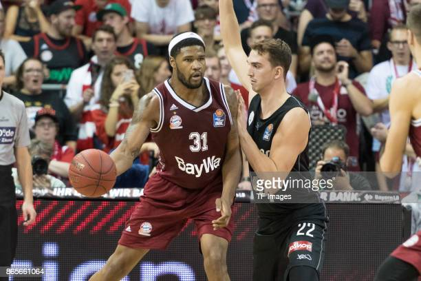 Devin Booker of Bayern Muenchen and Dejan Kovacevic of Wuerzburg battle for the ball during the easyCredit BBL Basketball Bundesliga match between FC...