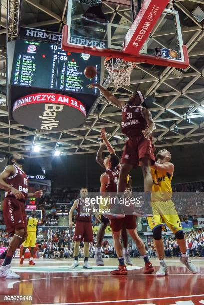 Devin Booker of Bayern Muenchen and Rasid Mahalbasic of Oldenburg battle for the ball during the easyCredit BBL Basketball Bundesliga match between...