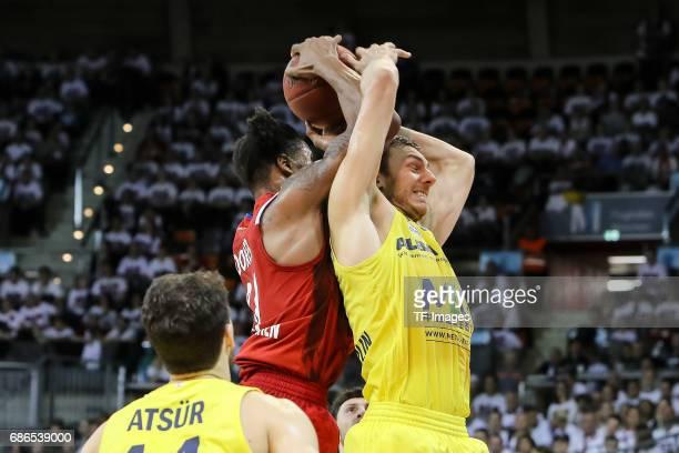 Devin Booker of Munich und Bogdan Radosavljevic of Berlin battle for the ball during the easyCredit BBL Basketball Bundesliga match between FC Bayern...