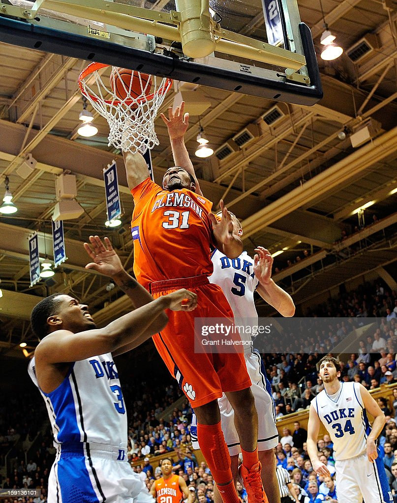 Devin Booker #31 of the Clemson Tigers dunks over Tyler Thornton #3 of the Duke Blue Devils during play at Cameron Indoor Stadium on January 8, 2013 in Durham, North Carolina.