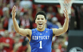 Devin Booker of the Kentucky Wilcats celebrates during the game against the Louisville Cardinals at KFC YUM Center on December 27 2014 in Louisville...