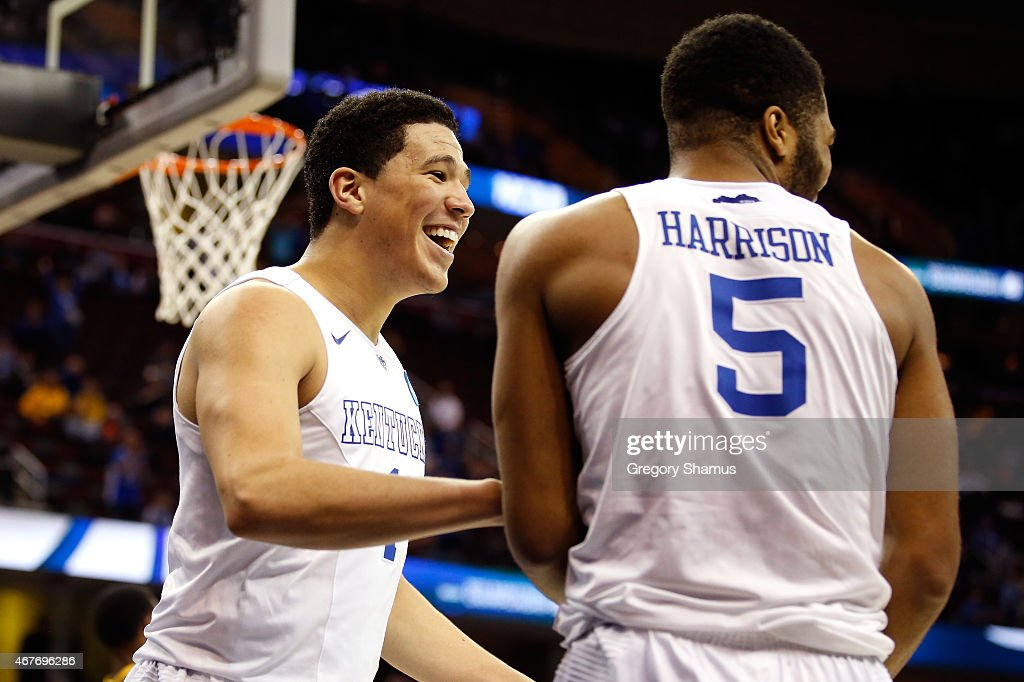 Devin Booker #1 of the Kentucky Wildcats reacts with Andrew Harrison #5 after a basket in the second half against the West Virginia Mountaineers during the Midwest Regional semifinal of the 2015 NCAA Men's Basketball Tournament at Quicken Loans Arena on March 26, 2015 in Cleveland, Ohio.