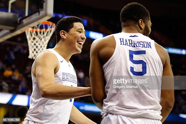 Devin Booker of the Kentucky Wildcats reacts with Andrew Harrison after a basket in the second half against the West Virginia Mountaineers during the...