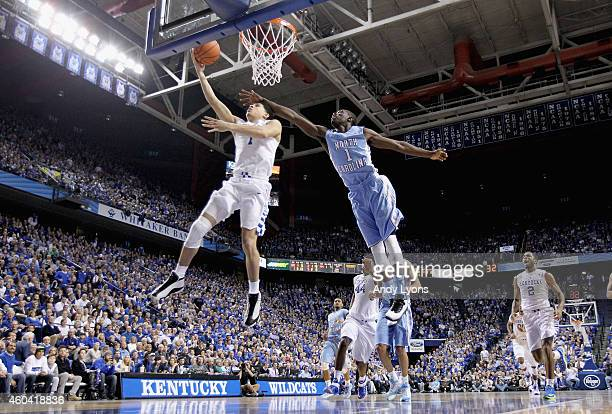 Devin Booker of the Kentucky Wildcats shoots the ball while defended by Theo Pinson of the North Carolina Tar Heels during the game at Rupp Arena on...