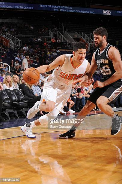 Devin Booker of the Phoenix Suns against Patricio Garino of the San Antonio Spurs during a preseason game on October 3 2016 at Talking Stick Resort...