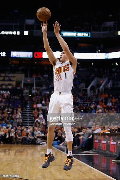 Devin Booker of the Phoenix Suns attempts a three point shot against the Indiana Pacers during the first half of the NBA game at Talking Stick Resort...