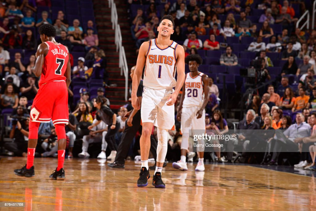 Devin Booker #1 of the Phoenix Suns celebrates a win against the Chicago Bulls on November 19, 2017 at Talking Stick Resort Arena in Phoenix, Arizona.
