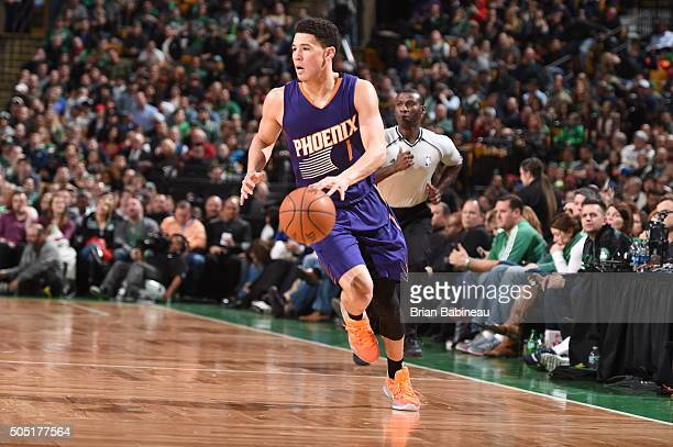 Devin Booker of the Phoenix Suns dribbles the ball against the Boston Celtics on January 15 2016 at the TD Garden in Boston Massachusetts NOTE TO...