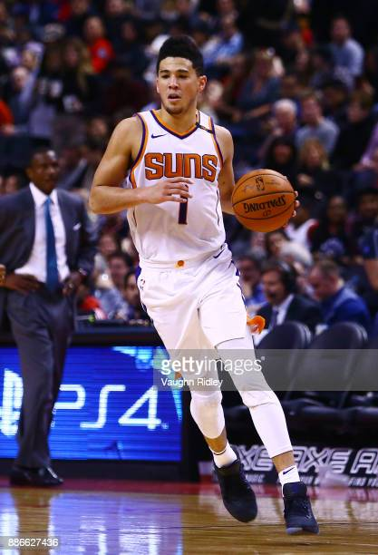 Devin Booker of the Phoenix Suns dribbles the ball during the second half of an NBA game against the Toronto Raptors at Air Canada Centre on December...