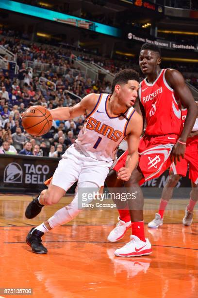Devin Booker of the Phoenix Suns drives to the basket against Clint Cappella of the Houston Rockets on November 16 2017 at Talking Stick Resort Arena...
