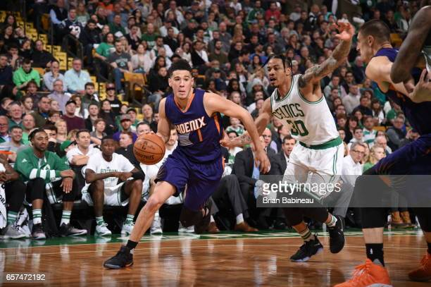 Devin Booker of the Phoenix Suns drives to the basket against the Boston Celtics on March 24 2017 at the TD Garden in Boston Massachusetts NOTE TO...