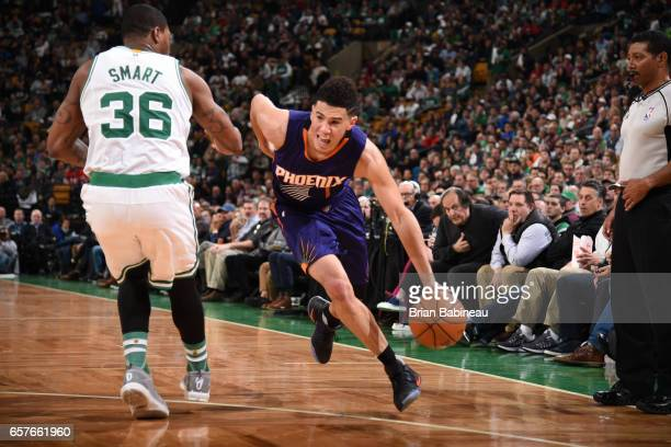 Devin Booker of the Phoenix Suns drives to the basket against the Boston Celtics on March 24 2017 at TD Garden in Boston Massachusetts NOTE TO USER...