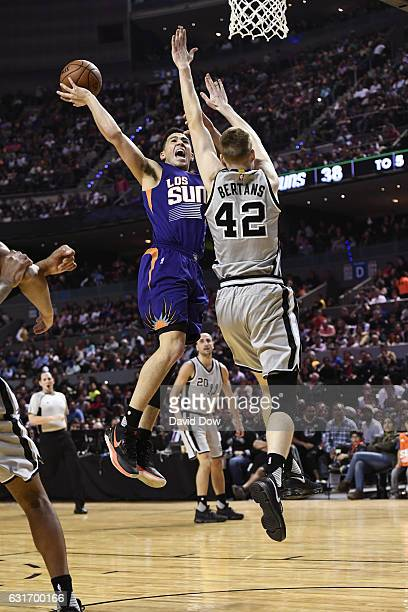 Devin Booker of the Phoenix Suns drives to the basket against the San Antonio Spurs as part of NBA Global Games at Arena Ciudad de Mexico on January...