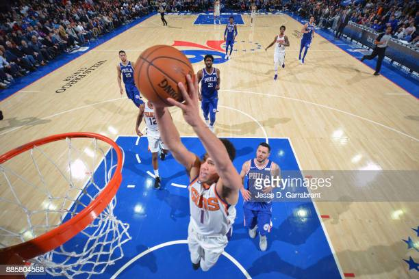 Devin Booker of the Phoenix Suns dunks against the Philadelphia 76ers on December 4 2017 at Wells Fargo Center in Philadelphia Pennsylvania NOTE TO...