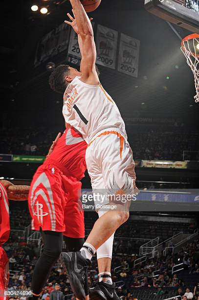 Devin Booker of the Phoenix Suns dunks the ball while guarded by Kyle Wiltjer of the Houston Rockets on December 21 2016 at Talking Stick Resort...