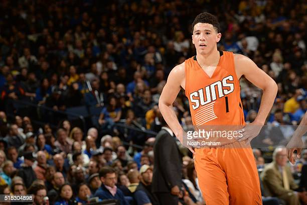 Devin Booker of the Phoenix Suns during the game against the Golden State Warriors on March 12 2016 at Oracle Arena in Oakland California NOTE TO...