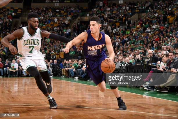 Devin Booker of the Phoenix Suns goes to the basket against the Boston Celtics on March 24 2017 at the TD Garden in Boston Massachusetts NOTE TO USER...
