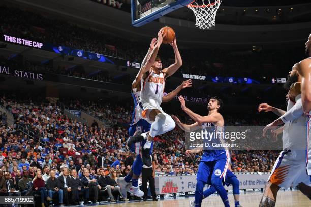 Devin Booker of the Phoenix Suns goes to the basket against the Philadelphia 76ers on December 4 2017 at Wells Fargo Center in Philadelphia...