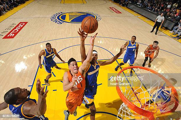 Devin Booker of the Phoenix Suns goes up for a rebound against Patrick McCaw of the Golden State Warriors during a game on November 13 2016 at ORACLE...
