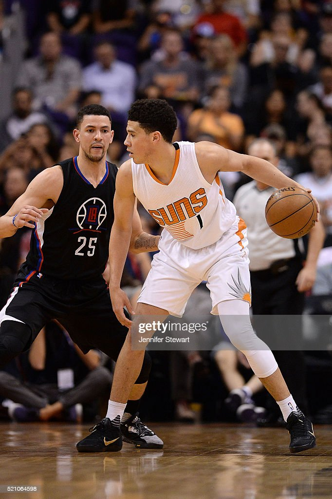 Devin Booker #1 of the Phoenix Suns handles the ball against Austin Rivers #25 of the Los Angeles Clippers in the first half of the NBA game at Talking Stick Resort Arena on April 13, 2016 in Phoenix, Arizona. The Suns defeated the Clippers 114 - 105.