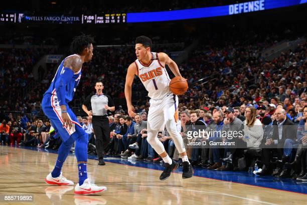 Devin Booker of the Phoenix Suns handles the ball against the Philadelphia 76ers on December 4 2017 at Wells Fargo Center in Philadelphia...