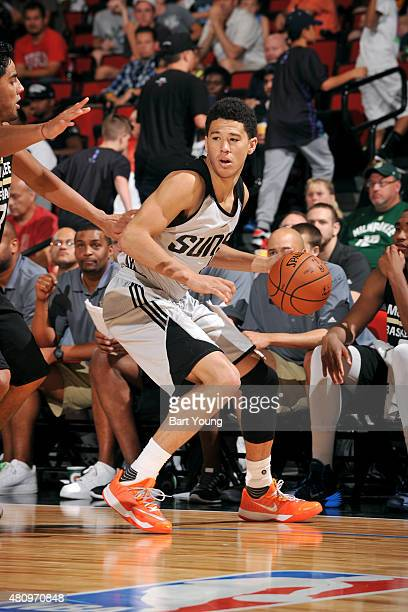 Devin Booker of the Phoenix Suns handles the ball against the Milwaukee Bucks during the 2015 NBA Las Vegas Summer League game on July 16 2015 at The...