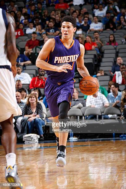 Devin Booker of the Phoenix Suns handles the ball against the Dallas Mavericks on October 21 2015 at the American Airlines Center in Dallas Texas...