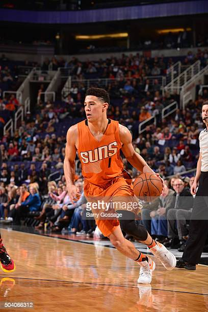 Devin Booker of the Phoenix Suns handles the ball against the Miami Heat on January 8 2016 at Talking Stick Resort Arena in Phoenix Arizona NOTE TO...