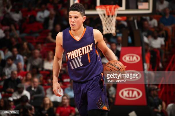 Devin Booker of the Phoenix Suns handles the ball against the Miami Heat on March 21 2017 at American Airlines Arena in Miami Florida NOTE TO USER...
